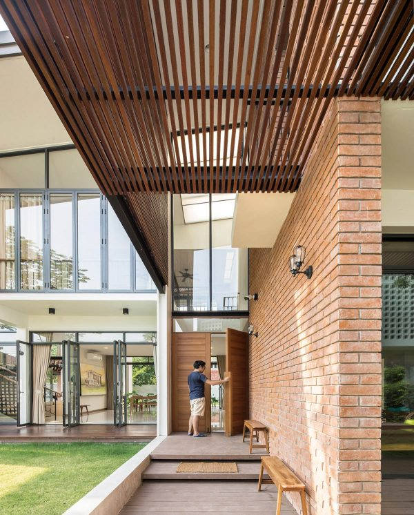 The interior opens to a spectacular double height living room crossed by a unique center beam staircase a wall of windows absolutely lavishes the interior