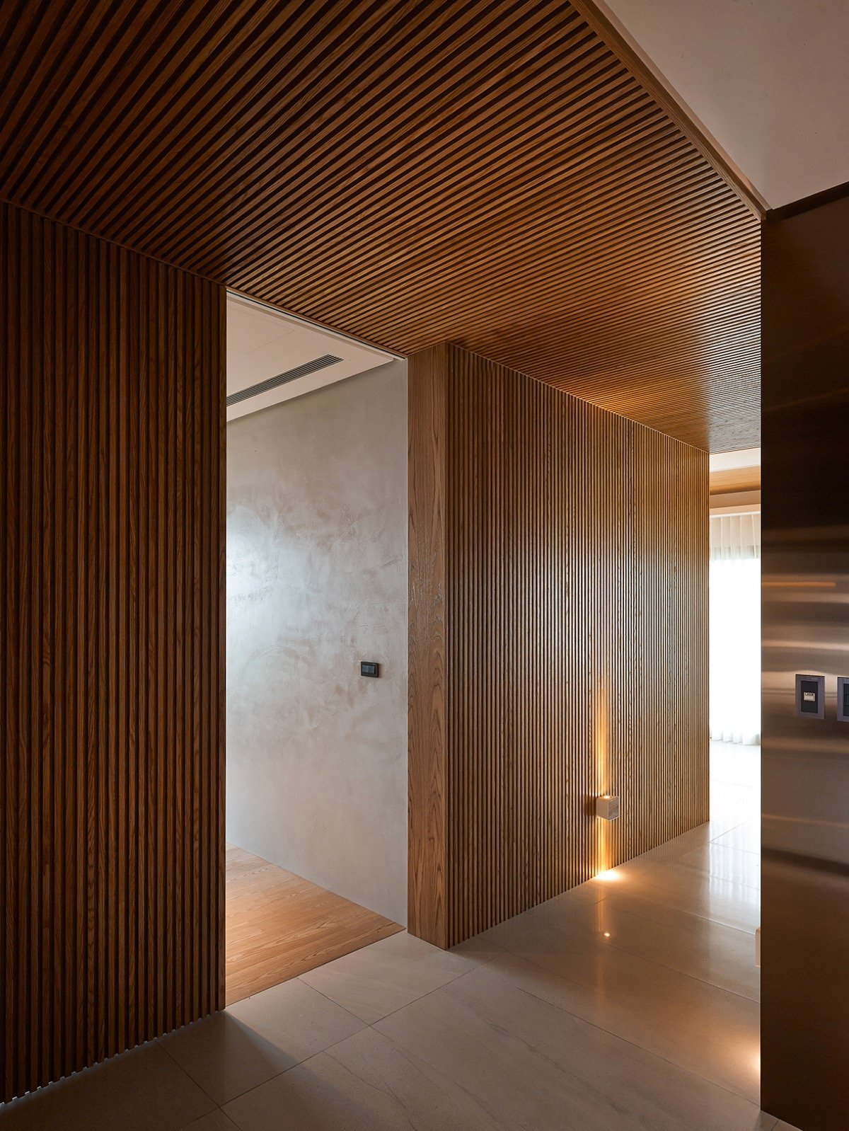 Wood Slat Wall - 4 homes with design focused on beautiful wood elements