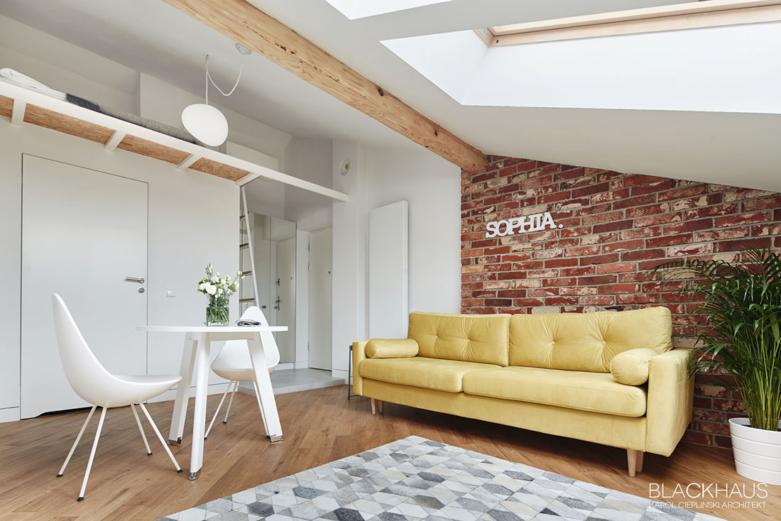 Yellow Sofa Against Exposed Red Brick Wall - 3 fabulous apartment designs with lofted bedrooms