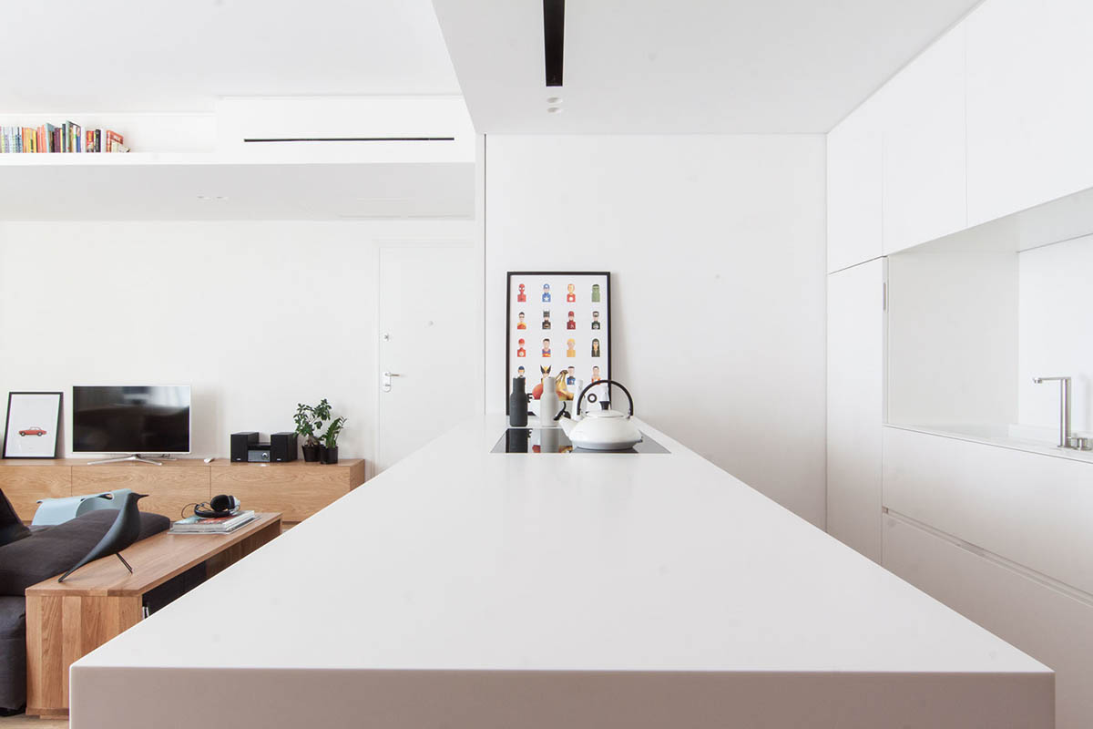 Leaning Cartoon Print Minimalist Kitchen - 3 light and bright apartments celebrating white space