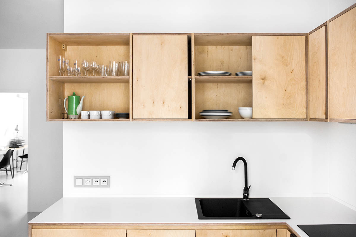 Wooden Plywood Cabinets Simple Kitchen - 3 light and bright apartments celebrating white space