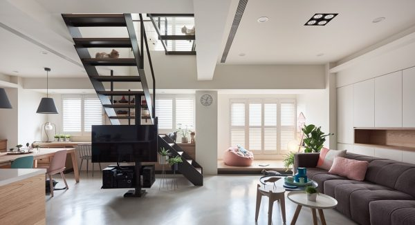 The two story home has lots of natural light and even feels a bit like a human sized version of a cat tree with its open stairwell in the center of the main