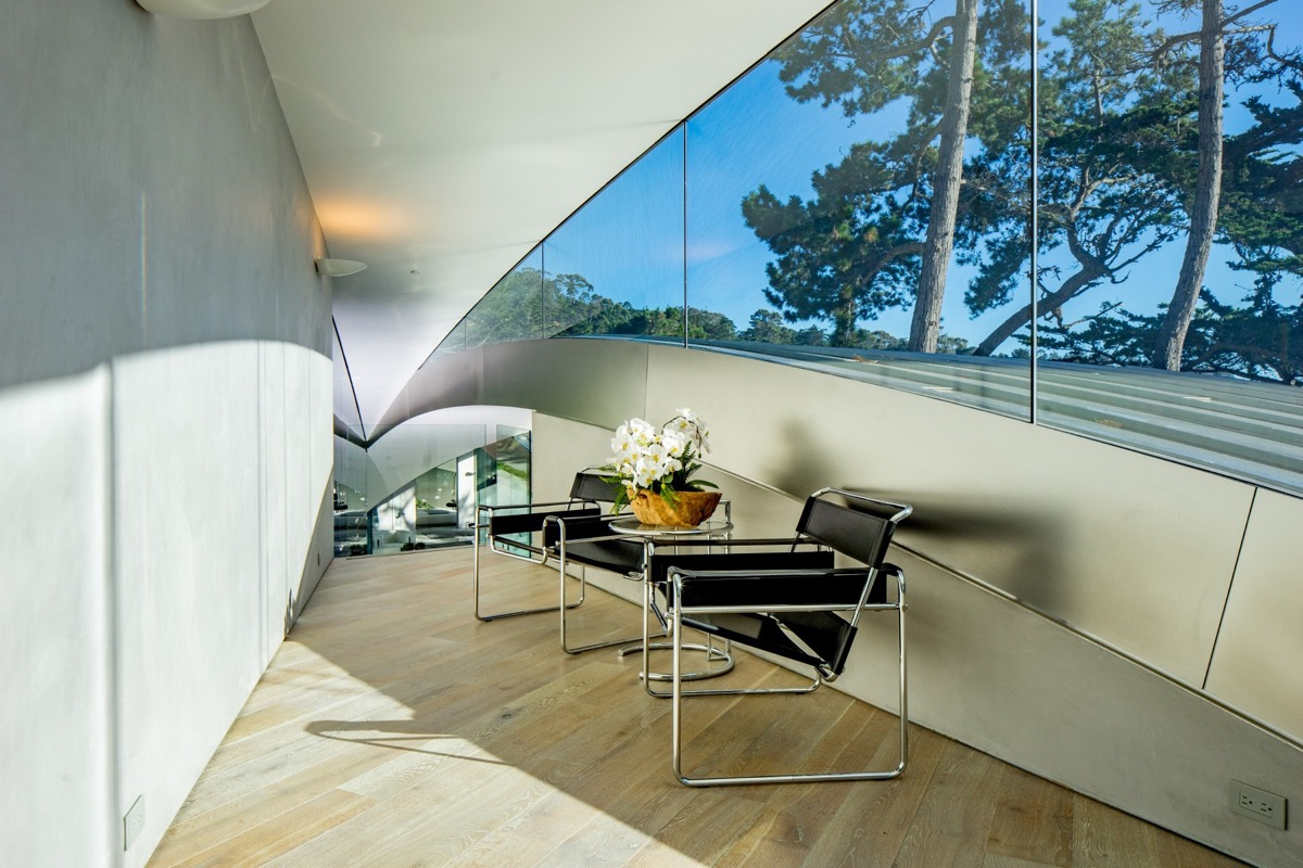 Classic Black Leather Reading Chair - A stunning butterfly inspired house on the california coast