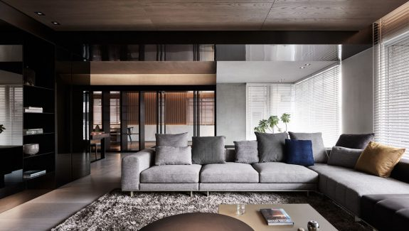 Black Acrylic, Glass and Stone Form This Dark and Sophisticated Apartment Interior