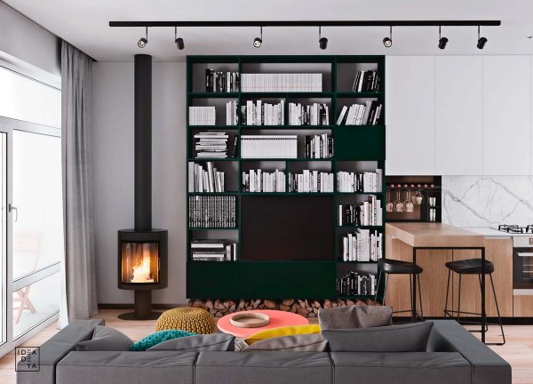 The Television Is Surrounded By The Home Library. A Neighbouring  Contemporary Woodburner Provides A Cosy Vista. The Bookcase Is A Deep Green  Colour Which ...