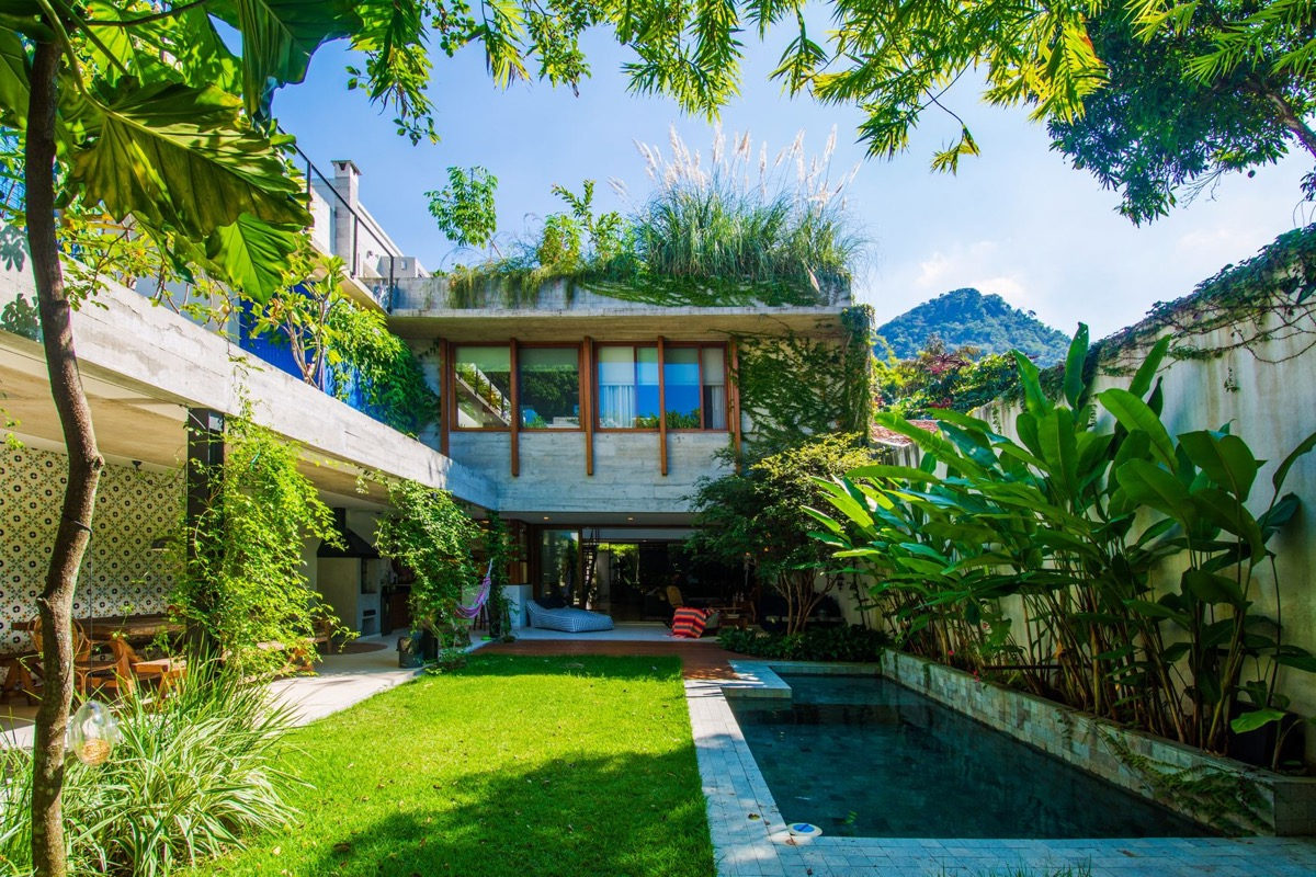 Open Tropical Home with Interior Courtyard and Stunning Wood Features