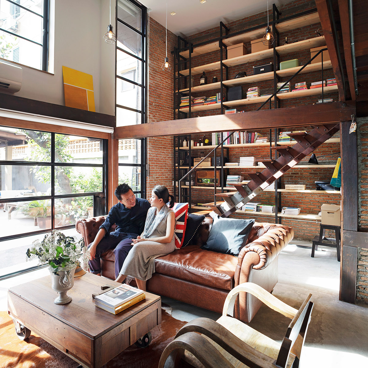 9  ; Photographer: Soopakorn Srisakul · Industrial Style Living Rooms Are A  Natural Fit For Brown Sofas.