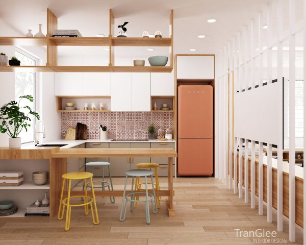 In the kitchen a coral coloured smeg fridge fills an alcove next to matching patterned tiles all shelving is wooden as is the breakfast bar that has been