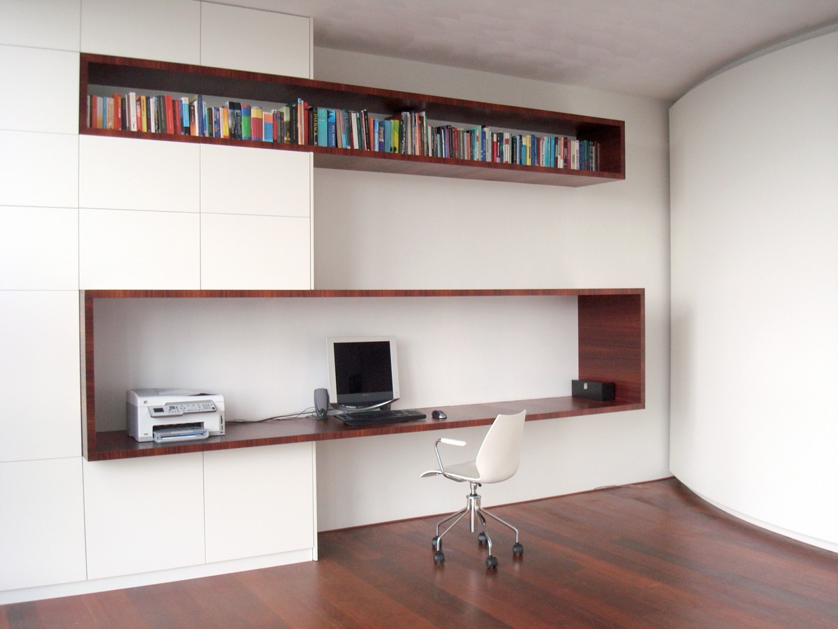 home office storage units. This Home Office Shelving Extrudes From A Bank Of Storage Units. The Higher Volume Acts As Bookshelf Whilst Larger Base Forms Computer Desk. Units
