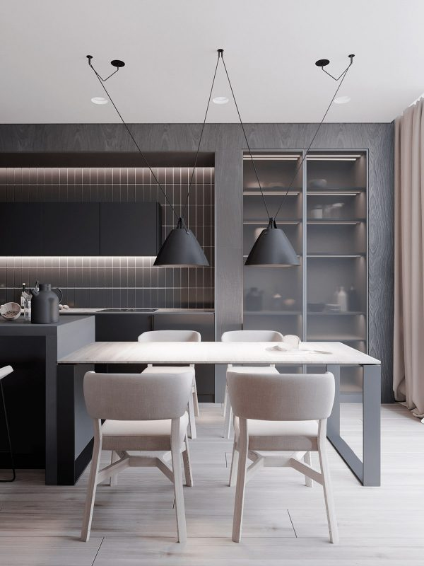 Black Dining Pendant Lights Are Suspended Low Over The Light Wood Dining  Table, Matching The Black Kitchen Units Behind. A Tall Larder Unit Has Been  Fitted ...