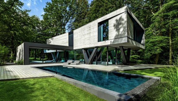 A Sculptural Concrete-Clad Modern Villa In Germany