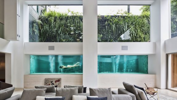 A Brazilian Art Collector's Home With A Luxurious Glass Swimming Pool