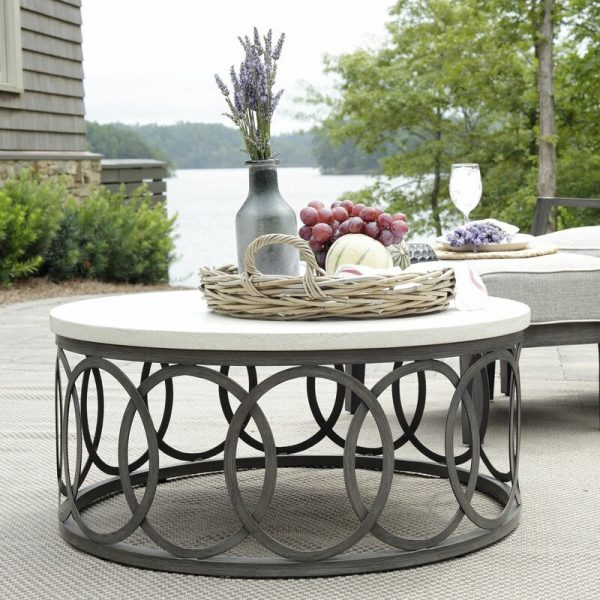 Home Design Ideas and Tips: round outdoor coffee table with wrought base and faux stone top chic patio furniture inspiration