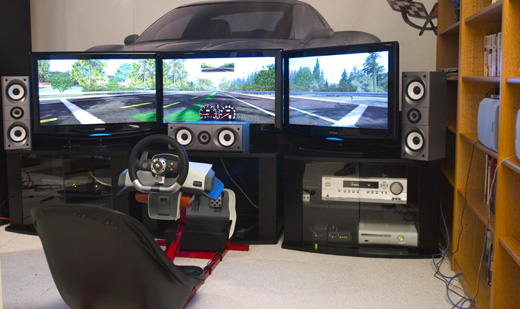 racing setup with Xbox 360 racing wheel and 5 1 surround speakers    Xbox Gaming Room