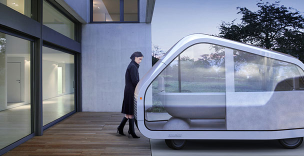 Passengers enter atnmbl from the curb side through an electric glass sliding door into a standing height entryway futuristic car interior