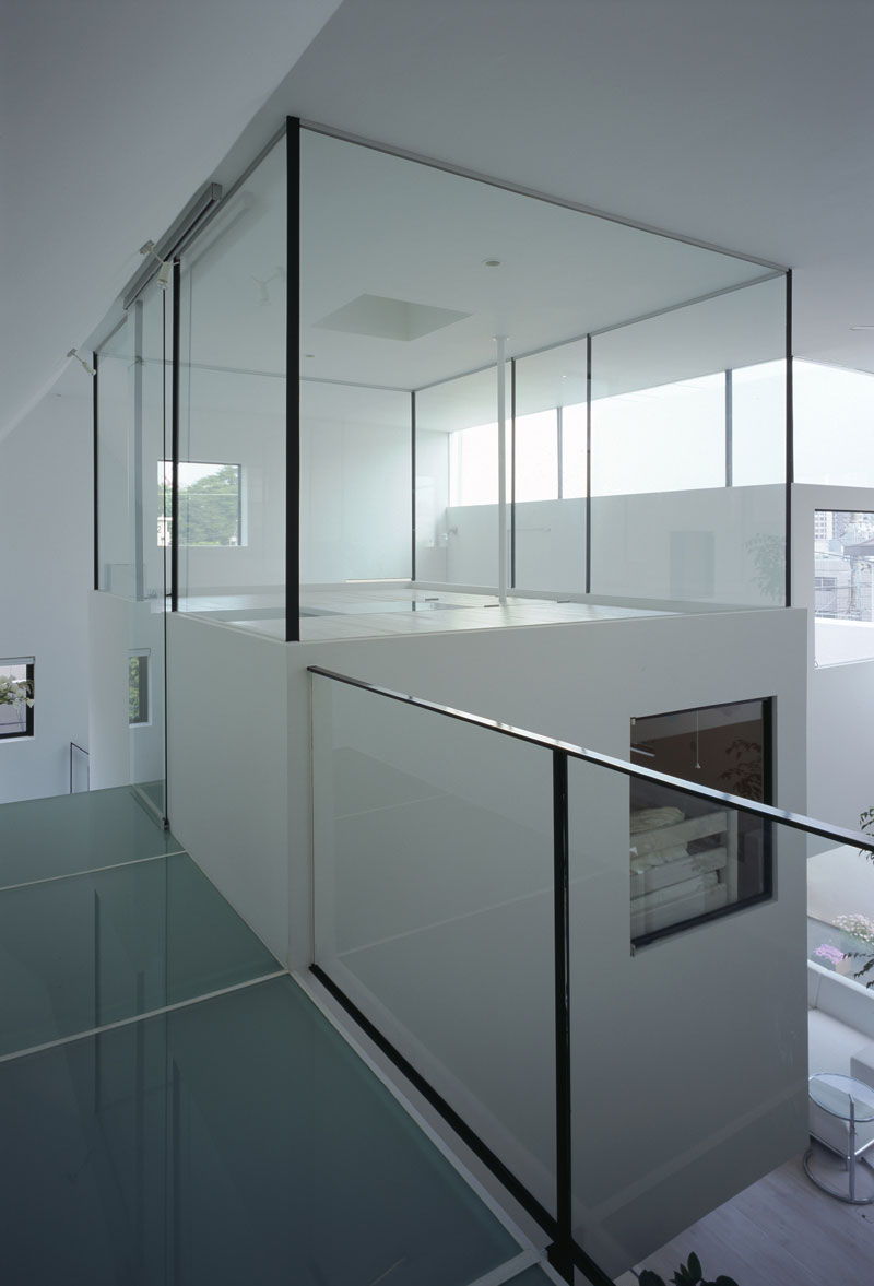 The house that parks a lamborghini in the living - Interior glass wall designs for houses ...