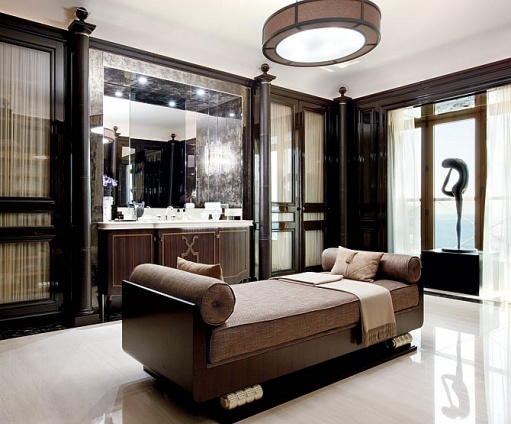 This must be the matching master bath suite where the sexta pendant lamp compliments the chaise and architectural details