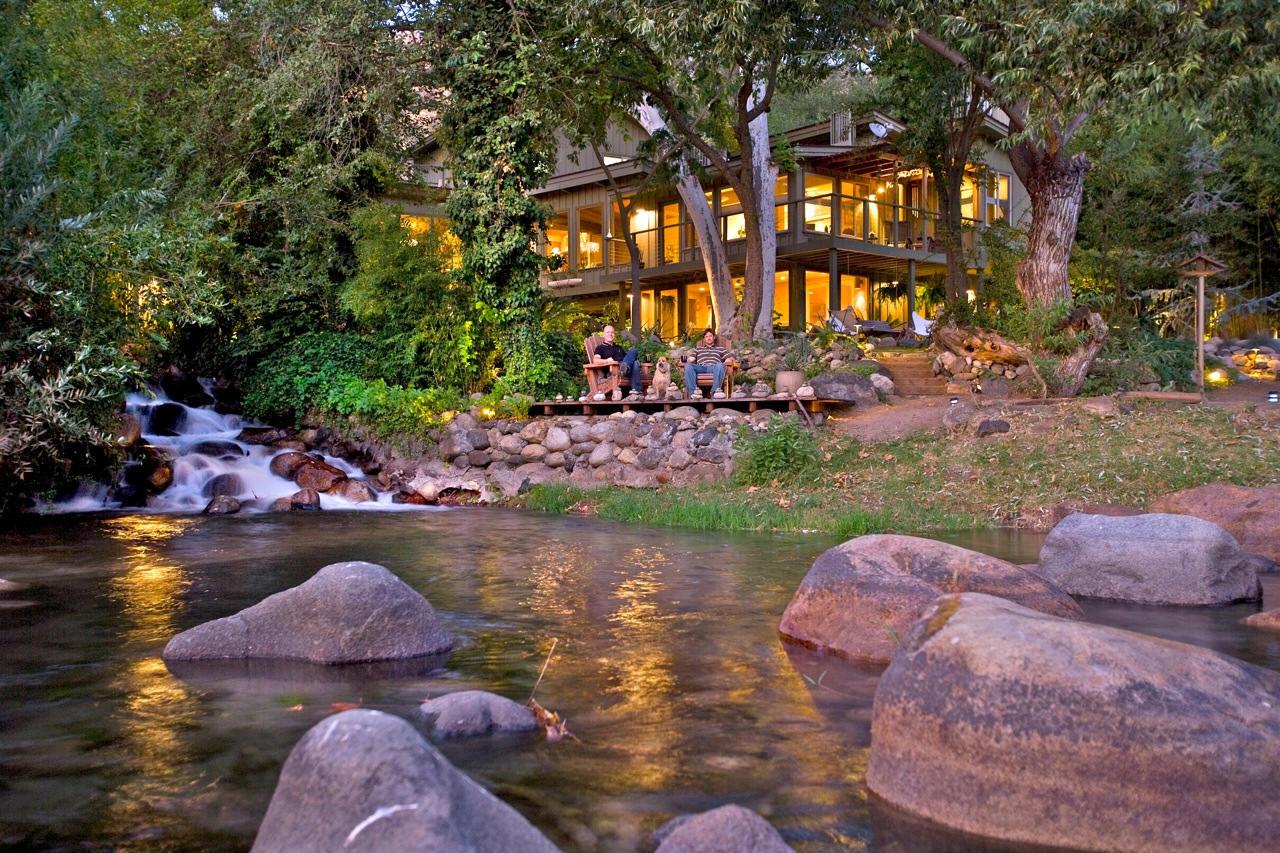 amazing house built across a river. Black Bedroom Furniture Sets. Home Design Ideas