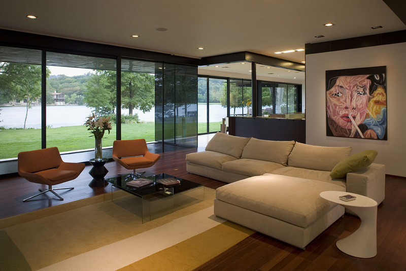 modern living room with lake view   Interior Design Ideas.