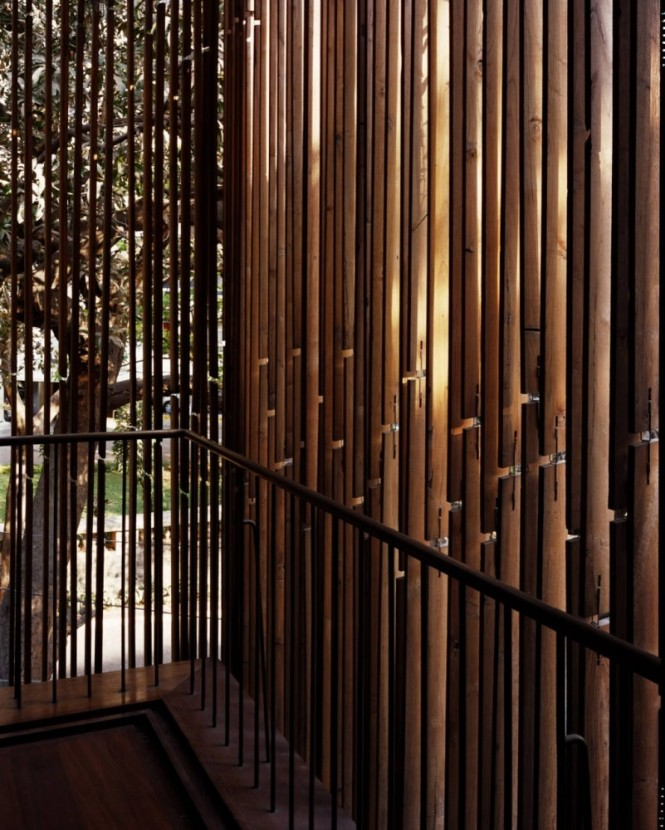 The internal décor pulls the outdoors inside by continuous use of bamboo wall treatments that play