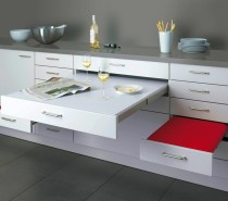 This pull-out dining design, by Alno, may look like a lightweight worktop extender, but features sturdy seats that can cope with loads up to 100 kilograms and a very generously sized table top that simply slides away after dinner.