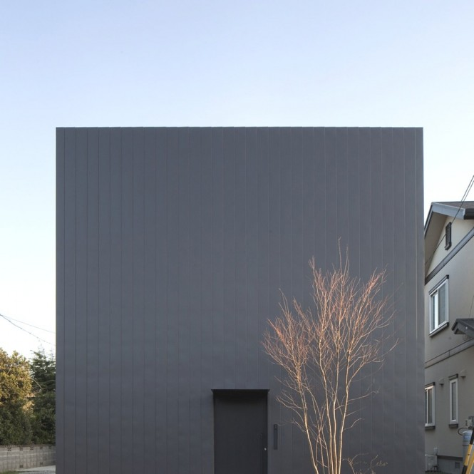 A married couple with three children inhabits the modern japanese house that from the outside appears