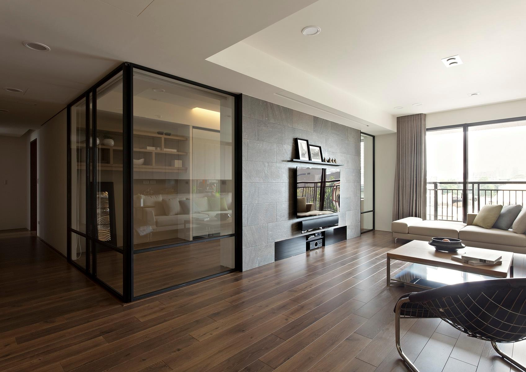 Apartment with a retractable interior wall