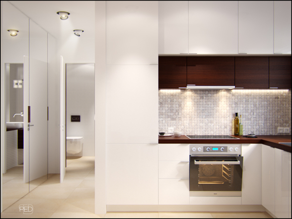 In the kitchen the white and dark wood color story continues in the units and worktops a small dining table keeps the food out of the living area for quick