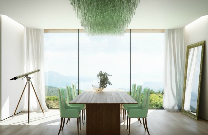 The minty hue used in this fresh dining space works perfectly with the tones over the
