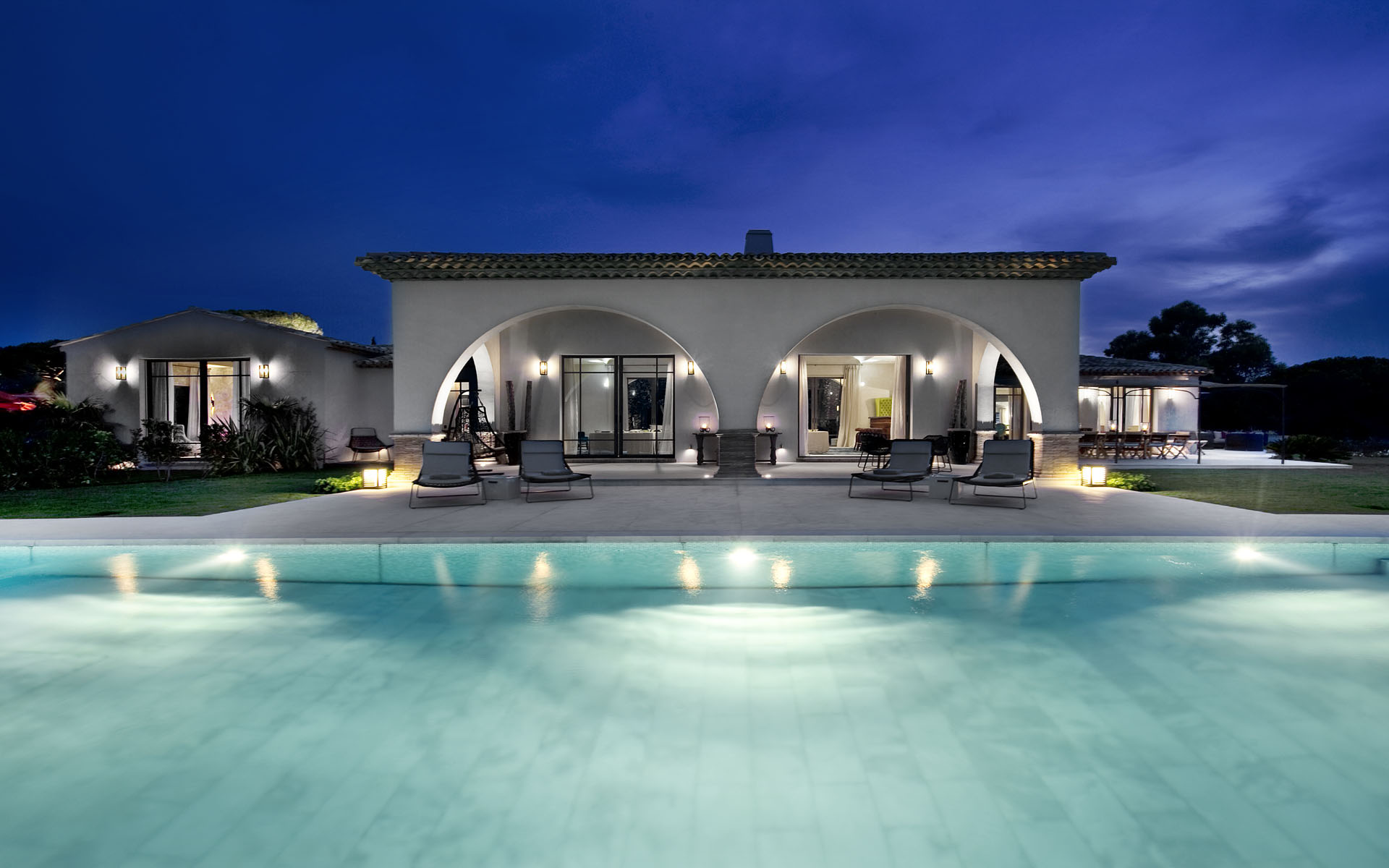 arched pool house at night | Interior Design Ideas.