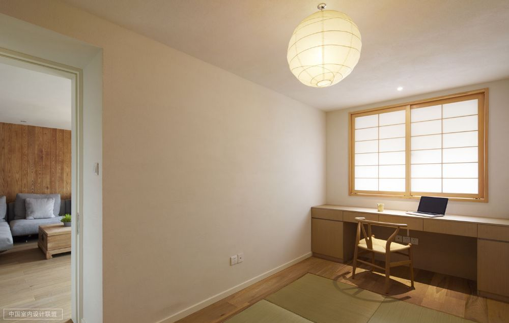 Clean Workspace With Bamboo Framed Rice Paper Window And