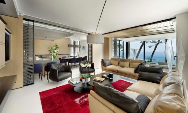 Các không gian sống được trang bị nội thất hiện đại thoải mái bọc và pops các dấu đỏ.