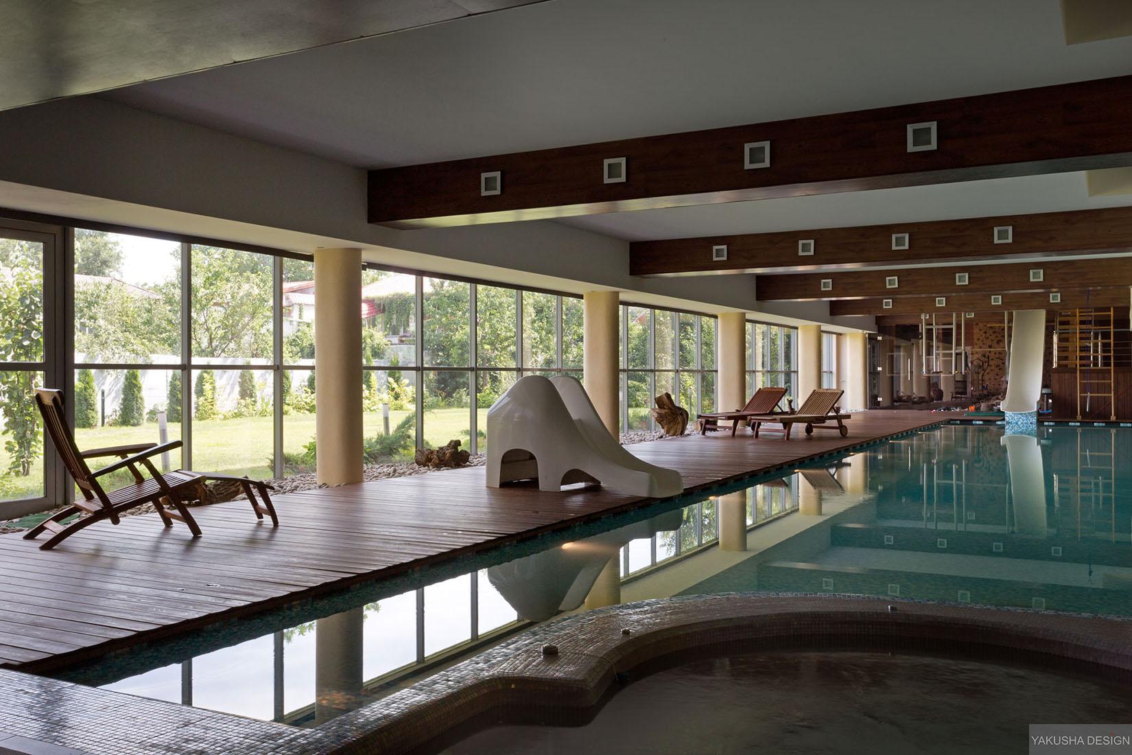 Impressive Exposed Beam Indoor Swimming Pool With Garden Views Daytime Interior Design Ideas