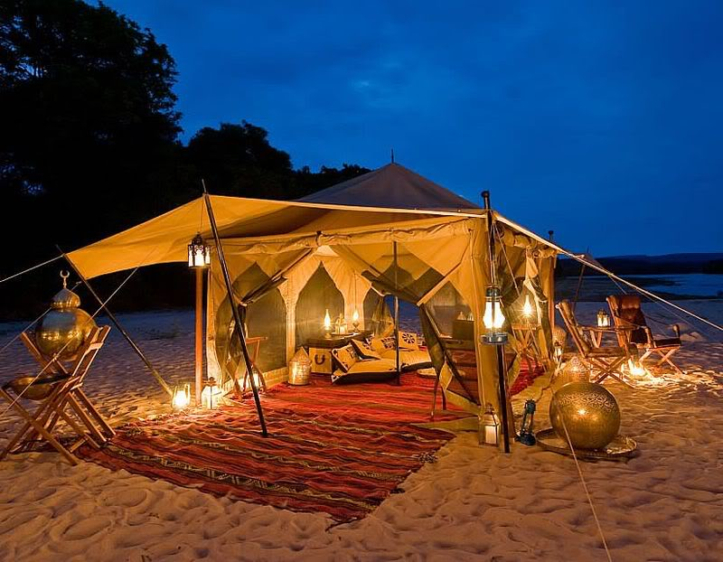 traditional bedouin beach tent with lanterns and outdoor dining ...