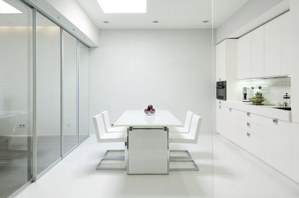 Kitchen Glass Walled In White With Sleek Cabinetry And