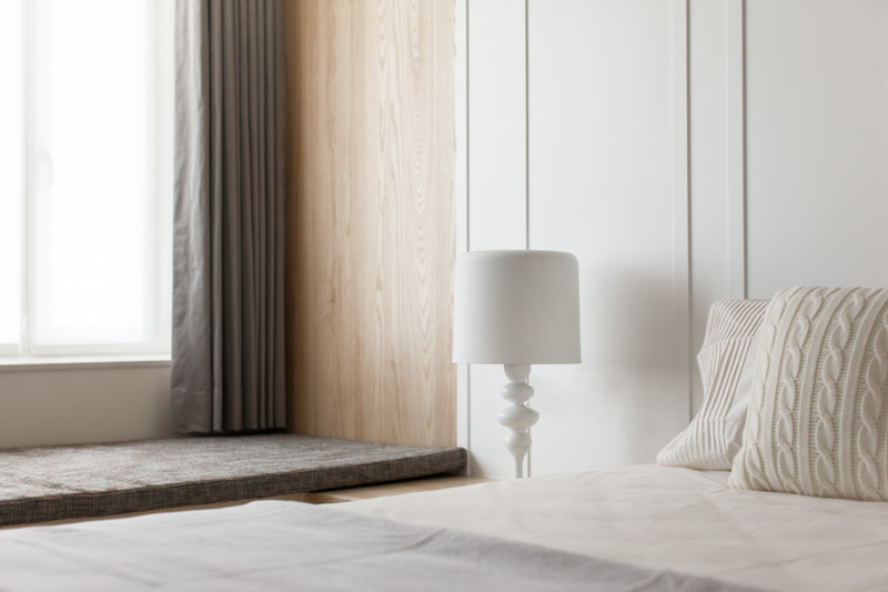 Bedside lighting modern apartment design maximizes space minimizes distraction