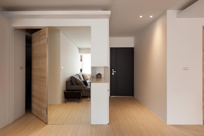 Corridor Design Color: Modern Apartment Design Maximizes Space, Minimizes Distraction