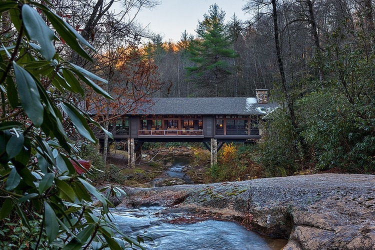 Bridge house home across a stream