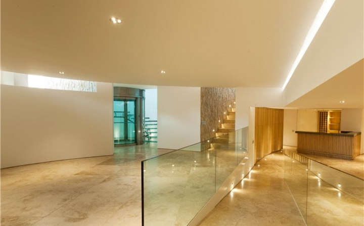 The lower ground floor holds all kinds of amenities including an office games room with bar and a wine cellar and a spa area complete with gym