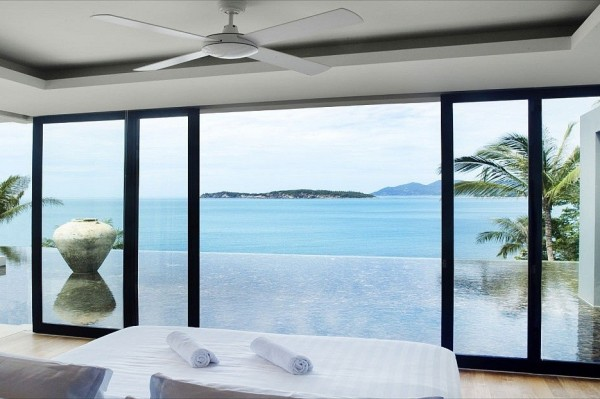 Simple white sandstone floors keep the home cool along with glorious sea breezes that blow
