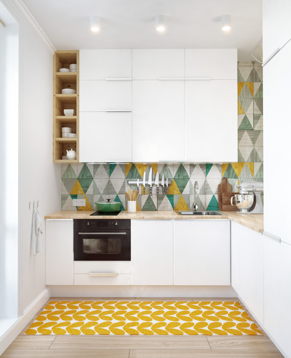 The simple white kitchen has been brought to life with unusual tiles and the vertical space used to its fullest with the installation of extra tall banks