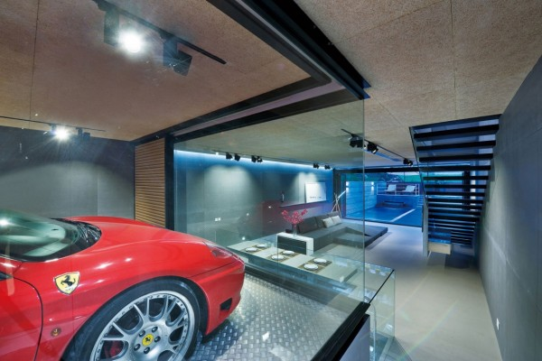 By turning the garage into a centerpiece for the downstairs living area the design allows