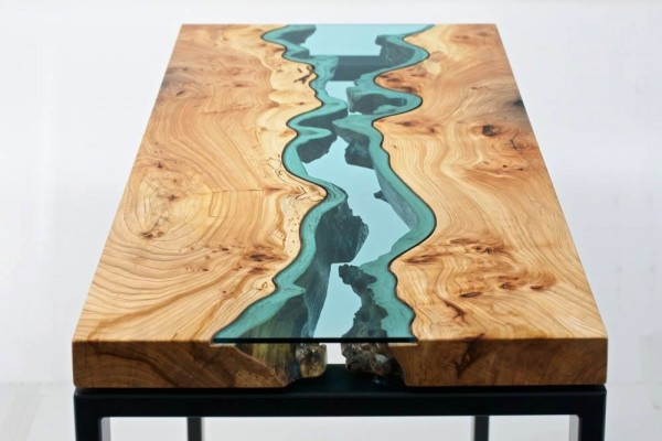 The amazing design here uses wood and class to create a coffee table that mimics real life topography.