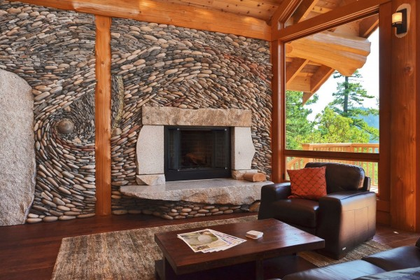 Working in concert with the natural wood elements in this cabin the stone designs add