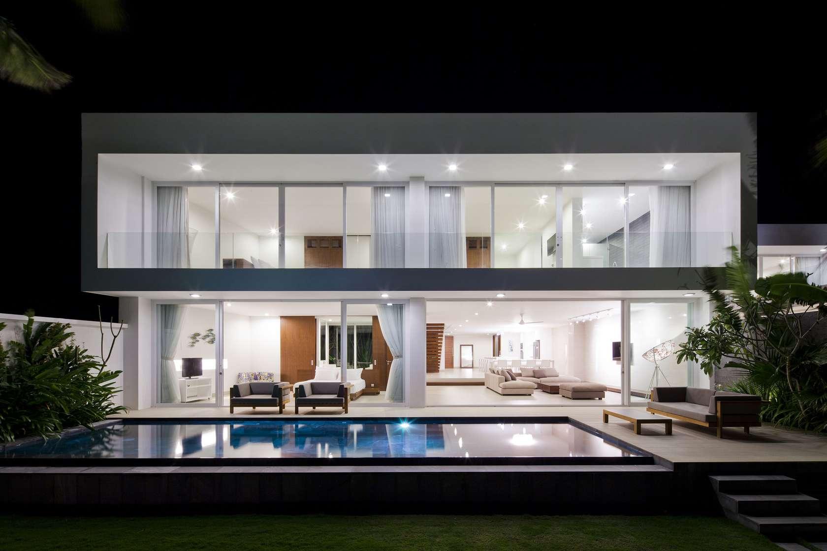 Nighttime beach view private beach villas offer spectacular ocean views and luxurious interiors