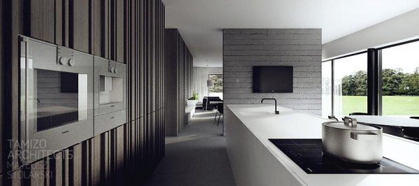 The majority of the interior is done in deep gray black and blinding white the resulting space is certainly sleek but manages to create its own energy