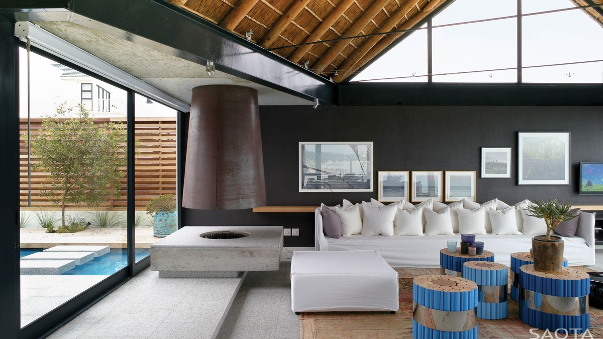 Thatched roof beach house with outdoor entertaining spaces - Beach house living room ...
