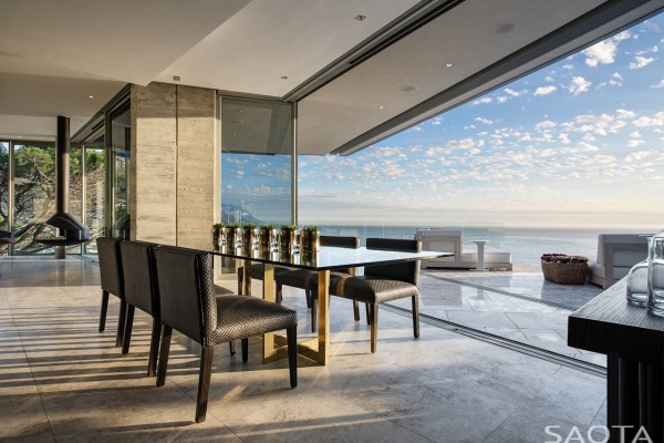 That means the family room lounge kitchen and dining room are each on the south end of the house with views of the spacious pool deck and its infinity