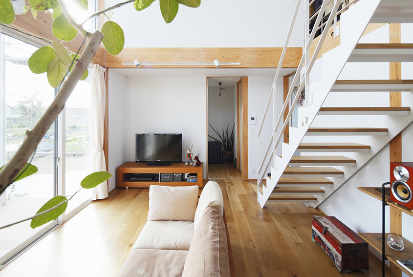 White staircase style simplicity in a japanese countryside prefab home