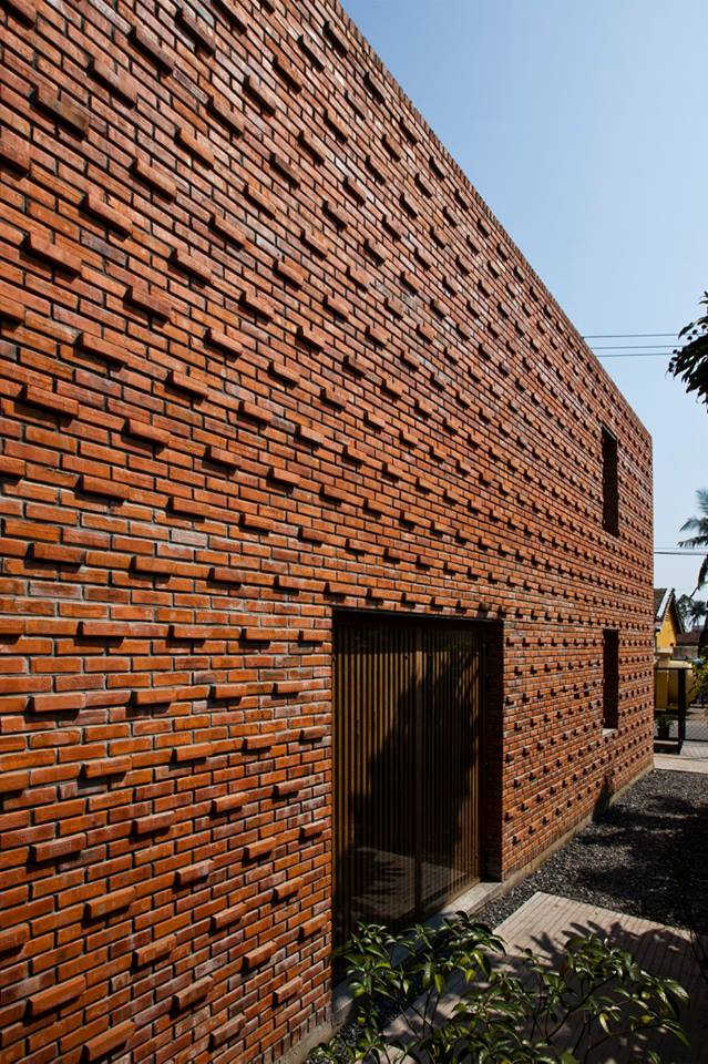 Red brick a creative brick house controls the interior climate and looks amazing